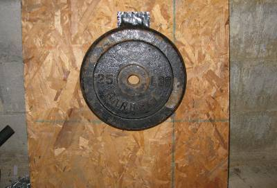 mounting magnet holding 25 pound barbell
