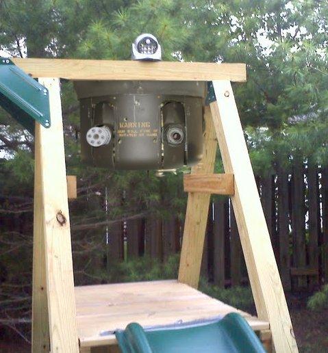 outdoor motion sensor light on swingset with machine gun turret